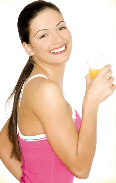 Woman having orange juice