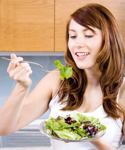 Woman having salad