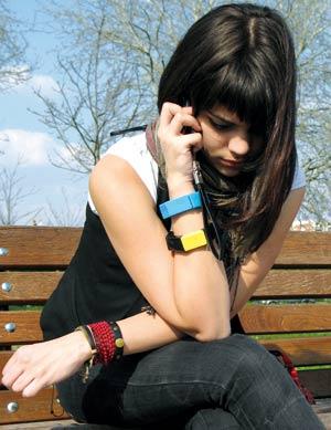 Sad girl talking on the phone