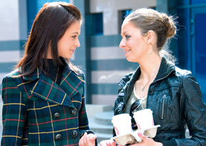 Two ladies talking to each other
