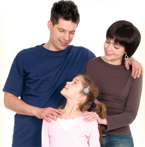 Parents holding a girl child