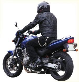 Man wearing helmet and riding bike