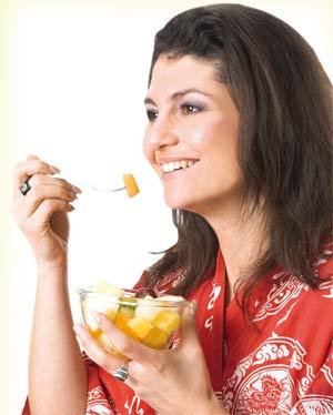 Woman having fruits