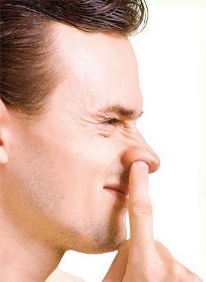 Man digging his nose