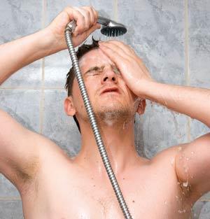 Man having a shower bath