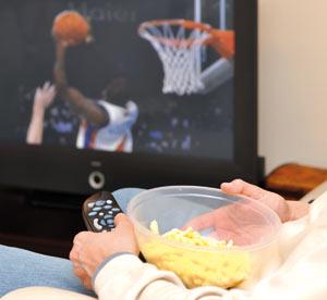 Watching TV and having snacks
