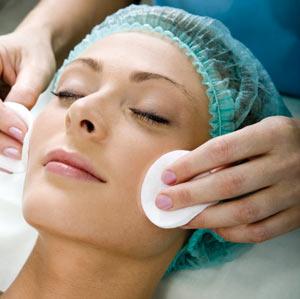 Woman having a face massage