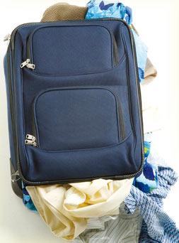 Travel bag burst due to overstuffing