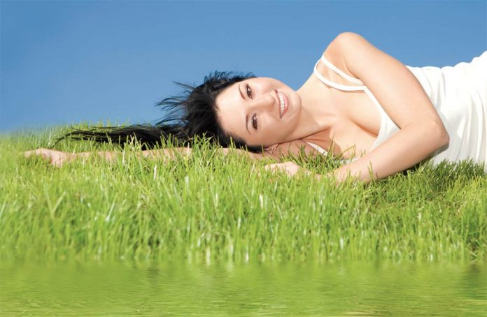 Calm woman lying on the grass