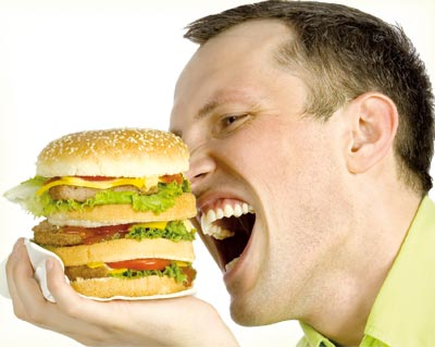 man having big size burger