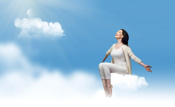 Woman sitting on cloud