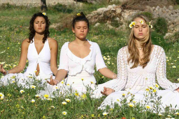 Three girls doing meditation