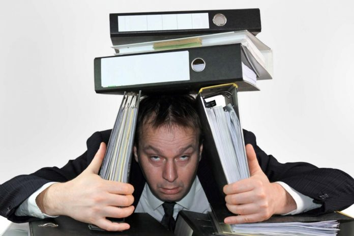 Man under the Folder files