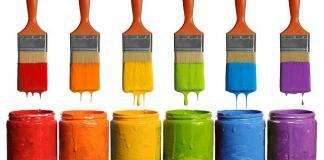 Different shades of wall paints with painting brushes