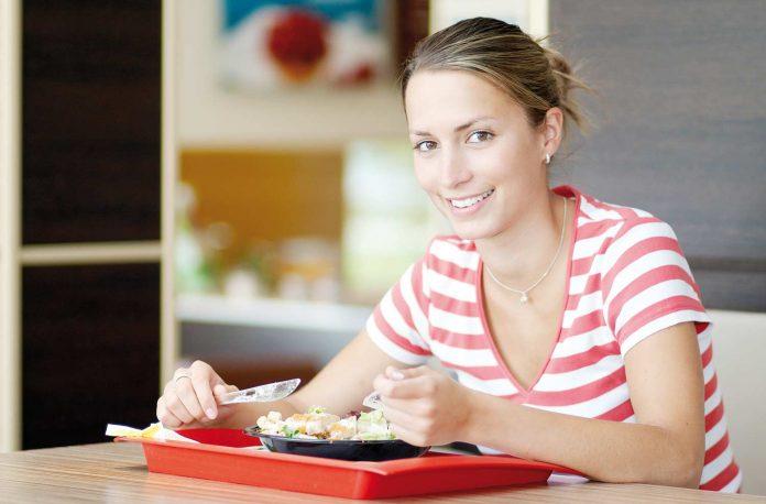 Woman having food