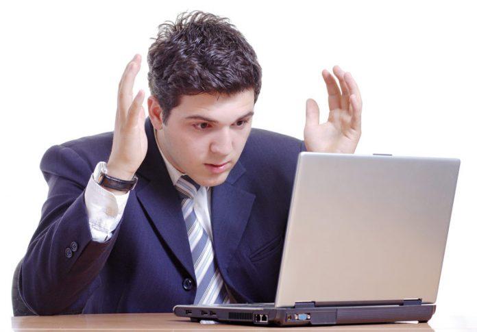 man looking tensed working in office