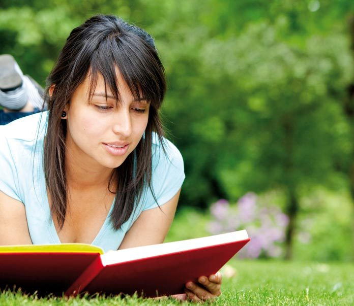 woman reading self help book