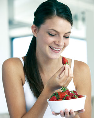 Woman having strawberries