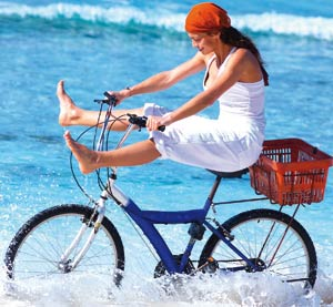 Woman riding a bicycle on the beach