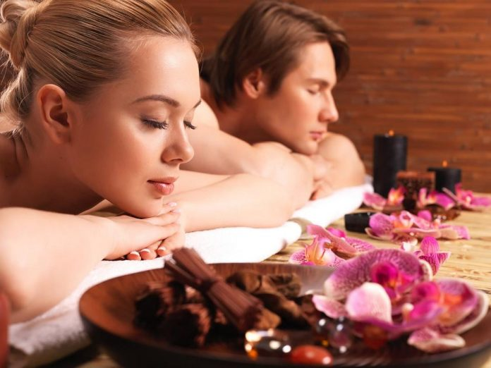 A couple relaxing in a spa getting a massage