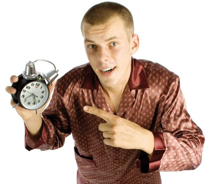 man with an alarm clock