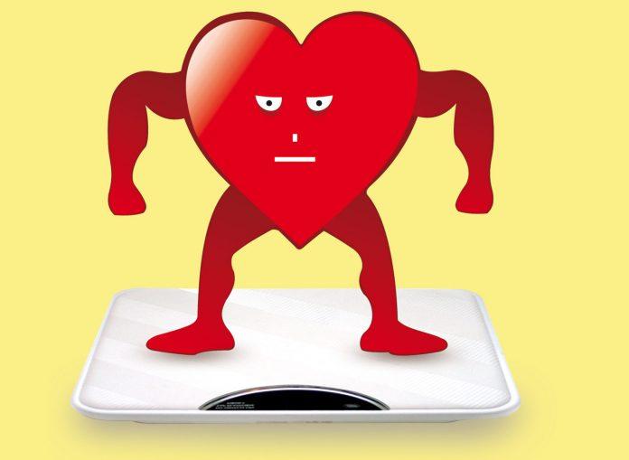 Illustration: Heart symbole man on weighing machine