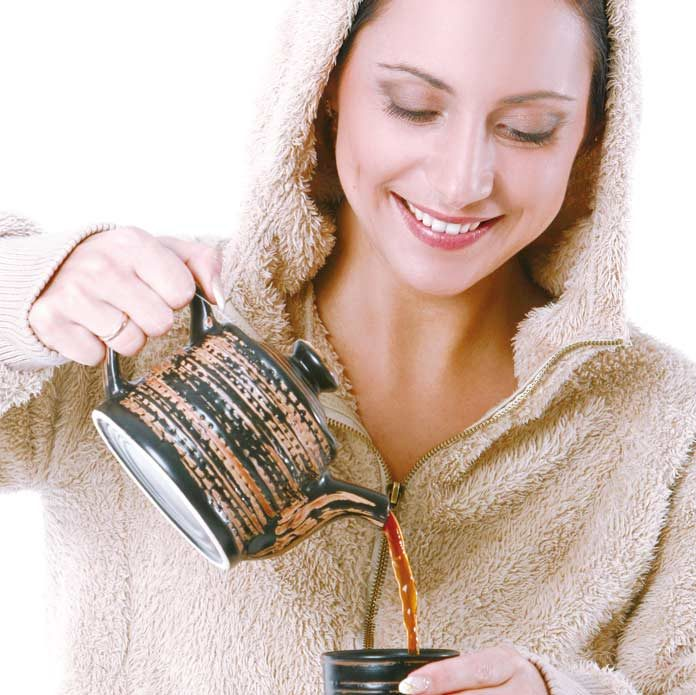 woman having hot black tea during winter