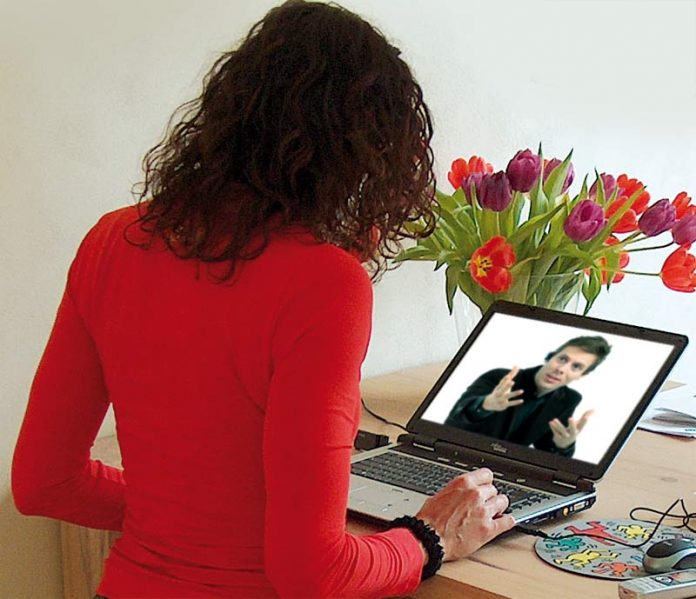Man and woman chatting on skype