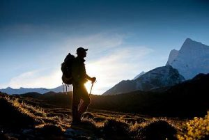 Man alone trekking in mountains
