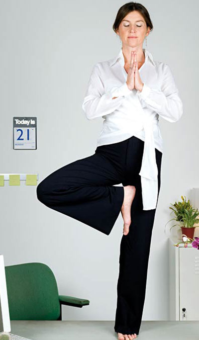 Woman meditating at workplace