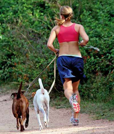 Woman jogging with her dogs