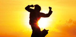 Man jumping against sunrise