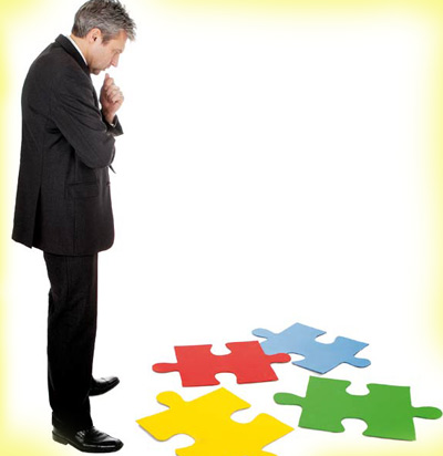 Man looking at a puzzle