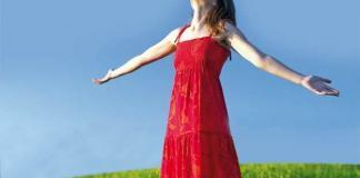 Woman looking towards the sky in gratitude