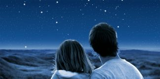 Man and woman gazing at the stars