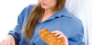 Woman having bread with tea