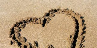 Heart sign drawn on the sand