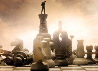 Man on top of one of the chess piece