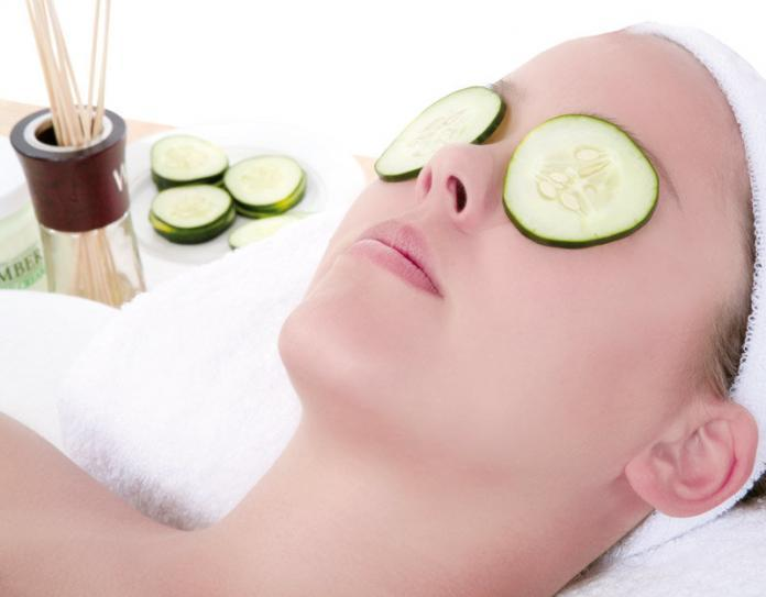 Woman placed cucumber for eye care