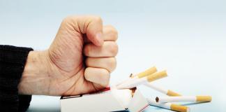 Man hitting a cigarette pack