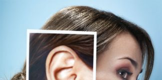 Woman with a closer picture of her ear