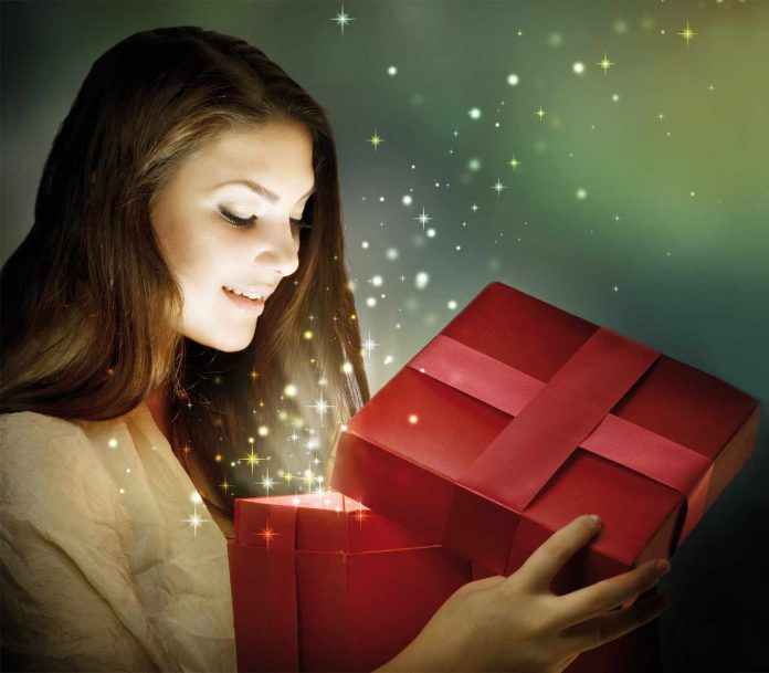 Woman opening the present with a smile