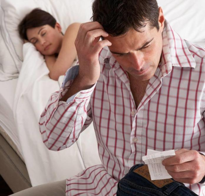 Man wondering about infidelity after checking partner's phone bill