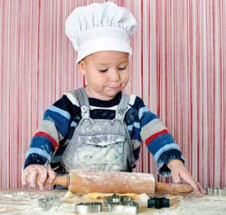 Kid trying out rolling a pancake