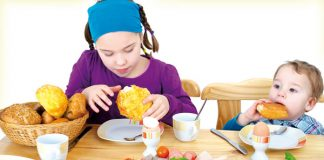 Kids playing with food items