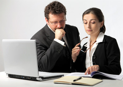 Man and woman discussing their work