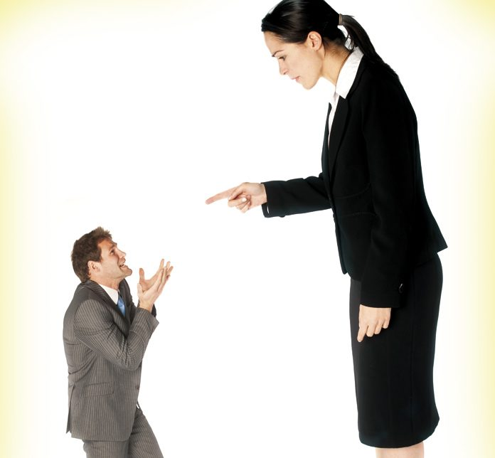 Woman pointing to man
