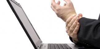 Man holding his wrist in pain