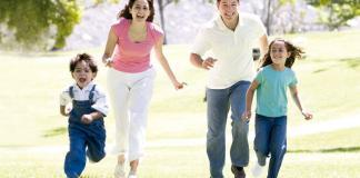Family enjoying and running in the park