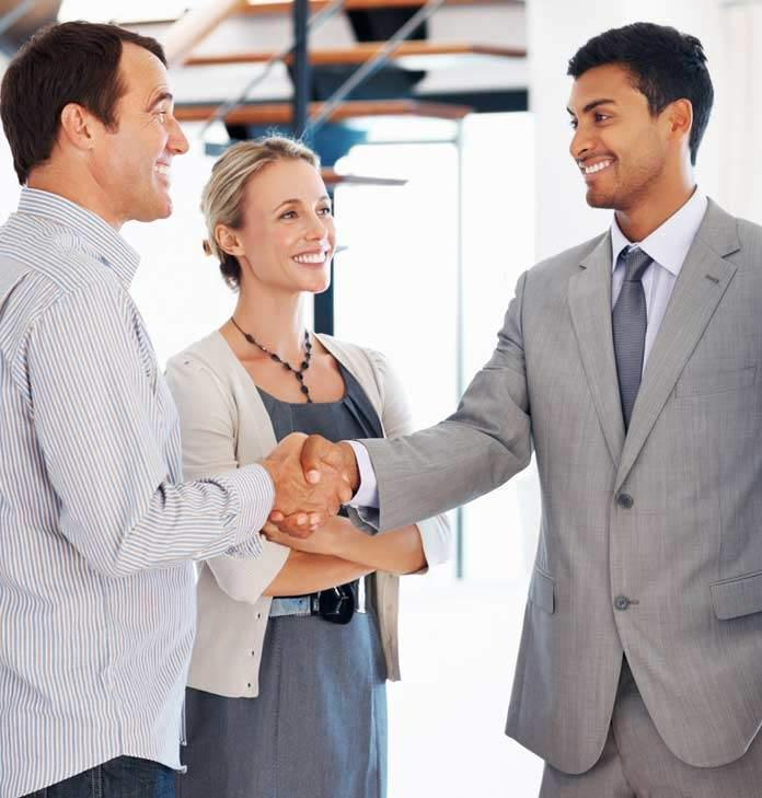 Man shaking hands with colleagues